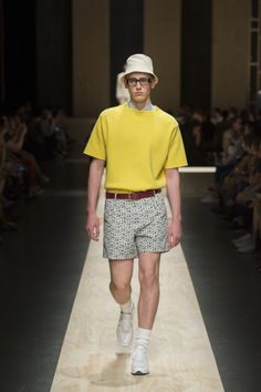 Yellow wide round neck cotton sweater, white and blue checked cotton shirt, cotton-linen print bermuda short, white calfskin laced sneakers, dark brown polished calfskin belt #canaliSS15 #mfw #ss15