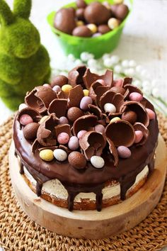 An intensely flavoured Hazelnut Cake with a Whipped White Chocolate Hazelnut Buttercream, topped with leftover Easter eggs. A delicious Easter cake recipe.