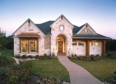 "ModelHomeGallery - David Weekley Homes.  what's the brick and stone combination used on this ""Chalon"" model in Austin?"