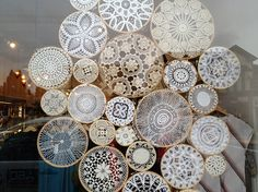This is such a pretty idea to put lace doilies in hoops and display! They look like snowflakes.