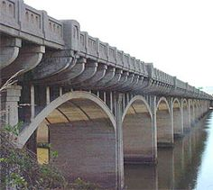 The 11th Street Bridge is a good example of a multi-span concrete arch bridge with verticals. It is a continuous span constructed of reinforced concrete. The roadway decking and guardrails are monolithic. It was altered in 1929 and has ornate guardrails that utilize Art Deco motifs, especially the Zigzag Art Deco and PWA Classical-oriented Art Deco. Tulsa Oklahoma