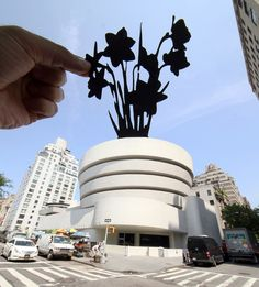 New York's Guggenheim Museum has been transformed into a vase for daffodil.  Rich McCore aka Paperboy