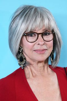 Flyaways are more noticeable with gray hair, so to ensure a sleek look like Rita Moreno's, opt for a frizz-fighting finishing product like Gloss Moderne High Gloss Serum ($45, sephora.com).