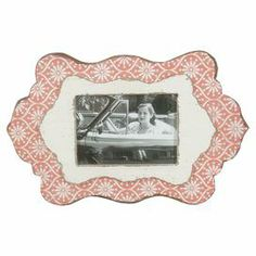 """Display cherished family memories with this vintage-inspired picture frame, showcasing a medallion motif and orange finish.  Product: Wall frameConstruction Material: Engineered woodColor: OrangeFeatures: Holds one photoDimensions: 11"""" H x 16"""" W x 1"""" D"""