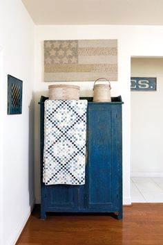 The background for this Irish Chain quilt is lovely, with bits of blues in muted colors, and dark blue emphasizing the pattern. Great home decor idea, too! Two Color Quilts, Blue Quilts, Small Quilts, Red And White Quilts, Blue And White, Dark Blue, Irish Chain Quilt, Quilt Display, Quilting Designs