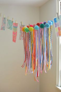 a collaborative kids DIY: make this chandelier with ribbons and pom-poms.