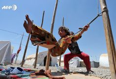 A picture taken on June 5, 2017 shows displaced Iraqi children playing at al-Khazir camp for the internally displaced, located between Arbil and Mosul. KARIM SAHIB / AFP