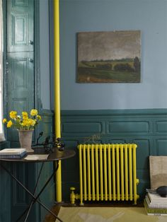 I like the idea of painting exposed pipes and radiators a contrasting color rather than trying to hide them away.