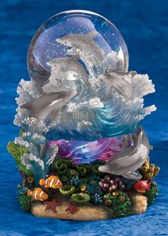 Lighted dolphin snowglobe.