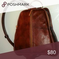 ITALIAN genuine leather backpack Gorgeous! Cognac soft rich leather.  Has front zippered pocket and larger back zippered area behind the cront pocket.  Has a sling strap to go over one shoulder.  Elegant classy lines.  Gorgeous brown leather.  Zero.flaws. Gold hardware Made In Italy Bags Backpacks