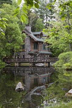 Log and stone house by river. Some people get all the luck :).