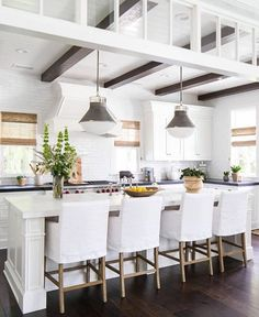 nice farmhouse style kitchen - love the pendant lighting