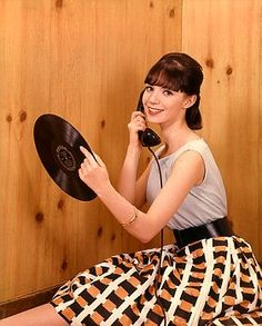 Teenage Girl Talking On Telephone And Holding LP Record May 16, 1962