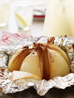 Grilled Onion Blossom -- The tender, sweet, caramely flavor of French onion soup is translated into a healthy living appetizer recipe, hot off the grill.
