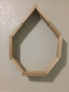 Custom made bedroom shelf made out of Popsicle sticks if you want to learn how to make this you can text me on Pinterest thanks!!!