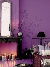 Cute gothic style purple bedroom. I love how the floor plan in the bedroom is open as if it were a living area as well
