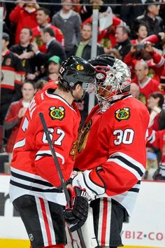 CHICAGO, IL - MARCH 26: Michael Frolik #67 of the Chicago Blackhawks congratulates teammate goalie Ray Emery #30 after the Blackhawks defeated the Calgary Flames 2-0 during the NHL game on March 26, 2013 at the United Center in Chicago, Illinois. (Photo by Bill Smith/NHLI via Getty Images)