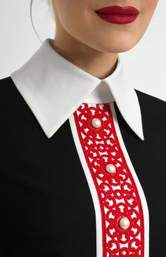 pearl buttons, pop of red and collared blouse