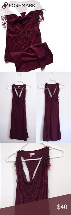 "silence + noise Maroon Faux Scarf Racerback Dress This dress is amazing! Super chill and comfy. Beautiful rich maroon in color. Front neck hem has a scarf looking detail on the dress, embroidered with small tassels hanging from shoulder to shoulder. Back has a twisted racerback. Great condition. Size small (I'm a small) fits true to size but not crazy tight like a bodycon dress. Nice slightly loose fit. Some stretch. 35"" Long, 32"" Bust (I'm a 34"" and totally fine), 31"" Waist, 38.5"" Hips…"