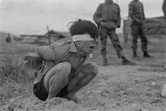 Viet Cong prisoner of war. A terrified VC prisoner awaiting interrogation unit of special forces A-109 Thuong Duc, 25 kilometers west from Da Nang, Vietnam. Jan. 23, 1967.