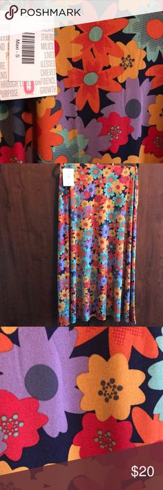 S LuLaRoe Floral Maxi Simply Beautiful!! Navy Background wth big Orange, Red, green, and yellowing flowers.   Maxi Skirts can also be worn as a tube dress or flip upside down for a pretty halter top. LuLaRoe Skirts Maxi