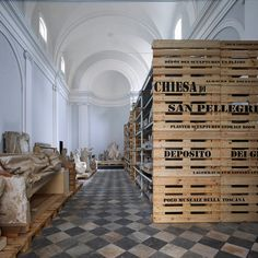 Storage crates form plinths for sculptures inside Microscapes Tuscan church conversion