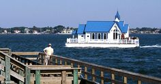 Celebrations: A wedding takes place on the Bay in Sarasota, Florida, as a man looks on at the odd sight from the pier