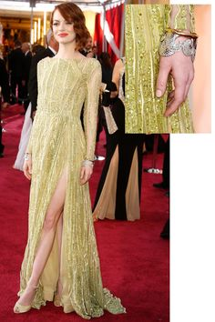 Emma Stone wore matching Tiffany Blue Book 18 karat yellow and white gold diamond cuffs on the red carpet, adding just the right amount of detail to her Elie Saab dress.   - HarpersBAZAAR.com
