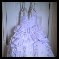 Formal Dress White Quinceanera formal gown, worn only once, has beading throughout, halter w/ lace up back. To get an idea of size I wear size 10 in pants and large in shirts this dress is an 8 and fits me perfect. Quinceanera Dresses