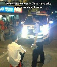 Chinese Police Punishing High-Beam Offenders