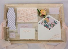 Orange calligraphy and a floral print envelope liner | Sideshow Press