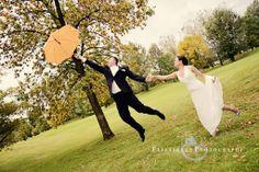 Wedding Photo. Bride and groom. Umbrella. www.elizabellephotography.com
