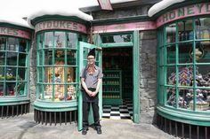 """Store keeper poses in front of a shop at Hogsmeade village in """"Wizarding World of Harry Potter"""" theme park at Universal Studios Hollywood, in Los Angeles, USA on April Get premium, high resolution news photos at Getty Images Parc Harry Potter, Harry Potter Theme Park, Harry Potter Magic, Harry Potter Decor, Harry Potter Hollywood, Harry Potter Experience, Potter Box, Shop Facade, Senior Trip"""