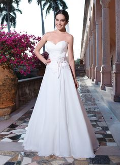 Sweetheart Gowns wedding dress style 6070  Chiffon, alencon lace A-line dress complemented by a sweetheart neckline.