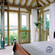 Master Bedroom with Exposed Oak Beams, Oak Frame Glazing and Panoramic Views
