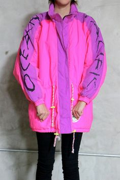 Ocean Pacific jacket, coat, 80s vintage neon pink purple puffy anorak jacket, womens large L cool 80s vintage Ocean Pacific neon pink and purple color blocked anorak jacket. hidden zip front w/ velcro top closure & drawstring waist. Block letter logo on left and right arm. side pickets. zips all the way up neck which can be folded or left standing. lightly puffed. neon yellow quilted lining w/ cool print. tag: Ocean Pacific fabric:nylon, polyester filling & lining gently used, minor signs...