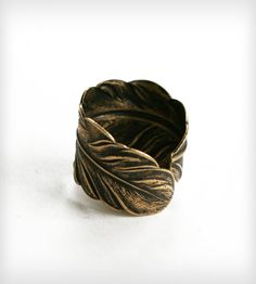 Adjustable Feather Ring by Chain Chain Chained on Scoutmob Shoppe. A brass ring with a nice patina.