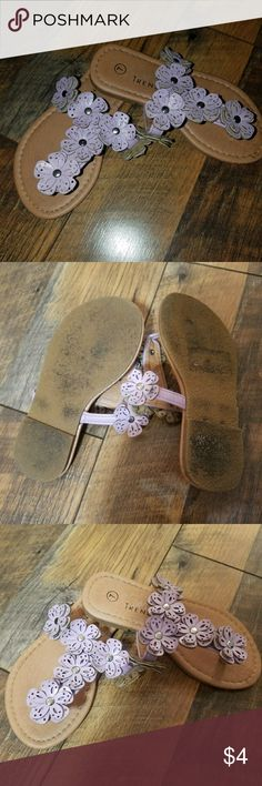 Purple sandals Cute lil sandals..my girl wore them outside once for just a lil while..size 7..Smoke and Pet free home!! Shoes Sandals & Flip Flops