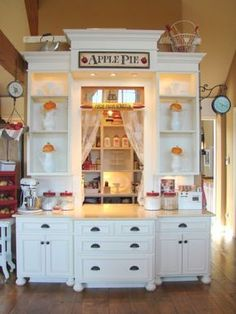 Check out this great baking center with a pass-through window to the pantry (Aunt Ruthie's Sugar Pie Farmhouse)