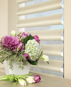 Welcome spring into your home with the soft light filtering beauty and elegance of Pirouette® window shadings ♦ Hunter Douglas window treatments #FloralArrangements