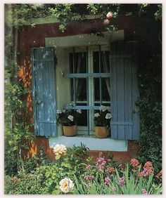 French farmhouse. I'm interested in the color and the look of the shutters, and also the window.