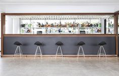 Onda stools from #STUA with black shell in this #bar #interior