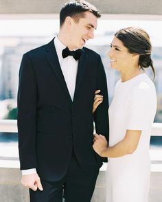 To finish off this bride's simply chic look, Bridal Hair by Ramona designed a loose, low bun with a sleek center part.
