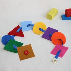Hey, I found this really awesome Etsy listing at https://www.etsy.com/listing/204341071/felt-button-snake-montessori-baby-busy