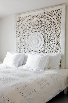 So fresh and bright. That carved headboard is amazing.