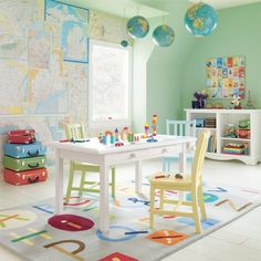 This is such a wonderful play room. I love that soft pastel green and the maps on the wall. The alphabet rug is also a winner for me. LOVE!!