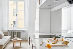 Even though I now have the tiny, perfect apartment of my dreams, I haven't stopped being fascinated with other people's tiny, perfect apartments. And I'm particularly drawn to this apartment in Stockholm, which despite measuring only 193 square feet manages to be everything you want an apartment to be: airy, stylish, cozy, comfortable.