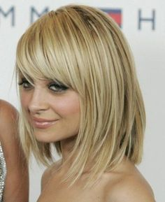 I truly miss being blonde! Absolutely Love her color. The cut is super cute too. But a long bob :| scares me