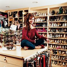 Belts & sunglasses displayed on a center island in the walk in closet of Paula Abdul