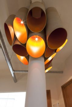 Unique cardboard tube lighting by Peldon Rose for Friends of the Earth, mixing the old with the new.